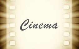 Strisce di pellicola del cinema con e raggi luminosi del proiettore fotografie stock