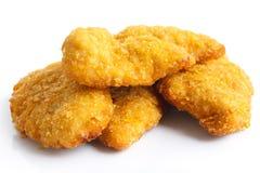 Strisce dorate del pollo fritto su bianco fotografia stock libera da diritti