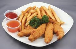 Strisce e fritture del pollo combinate Immagini Stock Libere da Diritti
