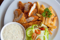 Strisce e fritture del pollo combinate Immagine Stock