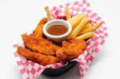 Strisce impanate del pollo con le patate fritte Fotografia Stock Libera da Diritti