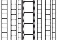 Striscia della pellicola da un lato verticale Fotografia Stock Libera da Diritti
