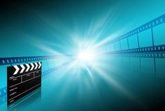 Striscia della pellicola della formica della scheda di applauso su priorità bassa blu Immagine Stock