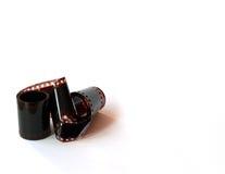 Striscia della pellicola della macchina fotografica isolata su priorità bassa bianca Fotografia Stock