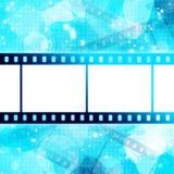 Striscia della pellicola sull'ardore blu Fotografia Stock