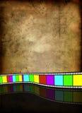 Striscia di pellicola su fondo d'annata illustrazione di stock