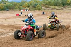 Striving for Leadership. SERPUKHOV, RUSSIA - OCTOBER 7, 2017: Polezhaev Artem 6,  Class ATV-JUNIORS, in the 4 stage  MX series, the Red Wings Cup 2017 super Royalty Free Stock Photos