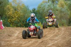Striving for victory. SERPUKHOV, RUSSIA - OCTOBER 7, 2017: Polezhaev Artem 6, Class ATV-JUNIORS, in the 4 stage MX series, the Red Wings Cup 2017 super country Royalty Free Stock Photography