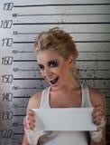 Strizzatina d'occhio della ragazza in prigione Immagini Stock Libere da Diritti