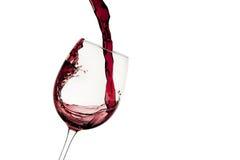 Strömendes Rotweinglas Stockbild