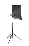 Strobe flash light with stand and softbox, isolated on a white background. Professional studio strobe. Studio flash with soft-box. royalty free stock photos