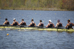 Stroke!. An 8-man crew team pulls together toward the end of their race Stock Photo