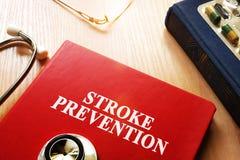 Stroke Prevention written on a book. Stroke Prevention written on a book cover Stock Photos