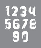 Stroked white numbers set drawn with real ink brush Royalty Free Stock Photo