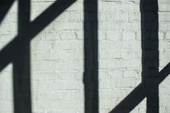 Strokenschaduw op bakstenen muur Royalty-vrije Stock Foto's