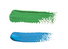 Strokes of blue and green paint isolated on white background Royalty Free Stock Image