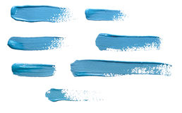 Strokes of blue paint isolated on white background stock image