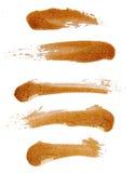 Strokes of golden nail polish Stock Photo