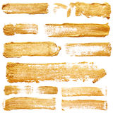 Strokes of golden paint Royalty Free Stock Photography