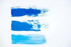 Strokes oil paint blue shades on a white background Royalty Free Stock Photography