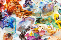 Strokes of oil paints on palette close up Stock Photos