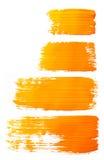 Strokes of orange paint Stock Photography