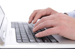Stroking the keyboard. Officework. Typing on a laptop computer Stock Image