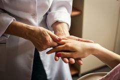 Stroking massage of hands close up,Hands massage in the spa salo Stock Image