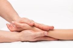 Stroking massage of hands close up Stock Photos