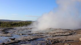 Strokkur Geyser erupting. HAUKADALUR - SEPTEMBER 11: Strokkur Geyser erupting at the Haukadalur geothermal area, part of the golden circle route in Iceland stock video footage
