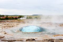 The Strokkur geyser about to erupt. The well known Strokkur geyser in Iceland about to erupt stock photos