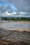 Strokkur geyser waiting to erupt in Iceland in summer. Close-up royalty free stock photography