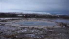 Strokkur geysir. Erupting three times in Iceland stock footage