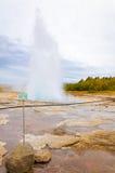 Strokkur Geysir eruption in autumn, Iceland Royalty Free Stock Images