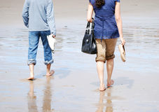 Stroll on the beach Royalty Free Stock Photos