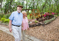 Stroll in the Park. Happy senior couple taking an afternoon stroll in the park stock photos