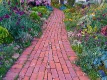 Stroll through a Southern California Garden. A flower garden and sidewalk in springtime in San Diego, California stock images