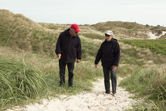 Stroll walk in the dunes. Retirees make holiday on the beach in denmark and against Royalty Free Stock Photography