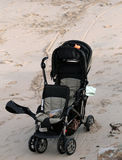 Stroller. Baby stroller parked on the beach Stock Photos