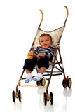 Stroller Baby. Beautiful baby boy in an umbrella stroller.  Isolated on white Stock Images