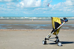 Stroller on the beach. Walking the stroller along the beach,  belgium Stock Images