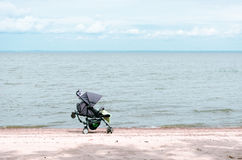 Stroller on the beach Royalty Free Stock Image