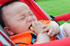 The stroller crying baby. A Chinese children crying in the park Stock Images