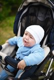 The stroller crying baby Stock Image