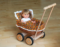 Stroller for doll. Made of wood Royalty Free Stock Image