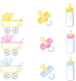 Stroller, pacifier and bottle Stock Photos