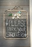 Stroller Parking. Please park strollers outside of store sign Royalty Free Stock Photo