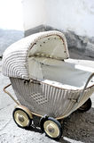 Stroller. The picture shows antique, wicker stroller Royalty Free Stock Images