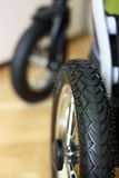 Stroller wheel. Children stroller wheels black tyre Royalty Free Stock Photo