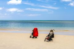 Strollers on beach with soft wave on blue sea and sky, Backgroun Royalty Free Stock Photos